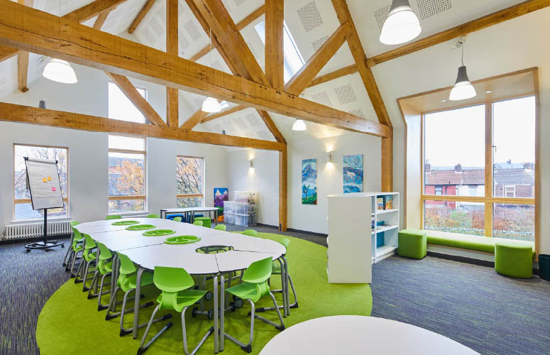 Arnot St Mary beautiful library and learning resource centre exposed beams green and white theme powerhubs to deliver mobile power